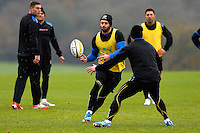 Luke Arscott passes the ball. Bath Rugby training session on November 25, 2014 at Farleigh House in Bath, England. Photo by: Patrick Khachfe / Onside Images