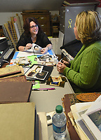 NWA Democrat-Gazette/FLIP PUTTHOFF<br />KEEPING TRACK OF HISTORY<br />Nicole Roy Nott (cq) (left) and Mandi Turner, with the Lowell Historical Museum, do inventory Wednesday Feb. 7 2018 at the museum, 304 Jackson Place, in downtown Lowell. Every item in the musuem's collection of more than 1,200 items has been photographed. The two worked Wednesday organizing the photos. Inventory keeps track of museum's collection, said Erin Virtue-Lawson (cq), musem manager. There is not room to display the entire collection, but a new museum planned for a site on Bellview Road in Lowell will have more space, she said. The museum is currently waging a campaign to raise $400,000 to build the museum. The museum is open from 9 a.m. to 2 p.m. Monday through Thursday and 10 a.m. to 4 p.m. on Saturday. Displays include items of Lowell and Ozark history, military exhibits and more. Admission is free. Group tours are available on request.