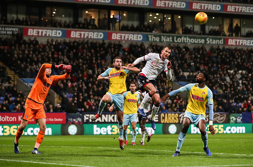 Bolton Wanderers' Christian Doidge meets a cross in the air<br /> <br /> Photographer Andrew Kearns/CameraSport<br /> <br /> The EFL Sky Bet Championship - Bolton Wanderers v Rotherham United - Wednesday 26th December 2018 - University of Bolton Stadium - Bolton<br /> <br /> World Copyright © 2018 CameraSport. All rights reserved. 43 Linden Ave. Countesthorpe. Leicester. England. LE8 5PG - Tel: +44 (0) 116 277 4147 - admin@camerasport.com - www.camerasport.com