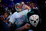 "Lucha Libre AAA fanm Christian McLaughlin boos the ""bad guys"" at a match in Sacramento, CA March 28, 2009."