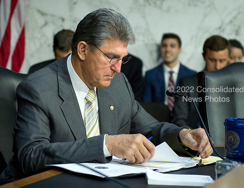 United States Senator Joe Minchin (Democrat of West Virginia) reads over the briefing book prior to the US  Senate Select Committee on Intelligence conductig an open hearing titled &quot;Worldwide Threats&quot; on Capitol Hill in Washington, DC on Thursday, May 11, 2017.  <br /> Credit: Ron Sachs / CNP<br /> (RESTRICTION: NO New York or New Jersey Newspapers or newspapers within a 75 mile radius of New York City)