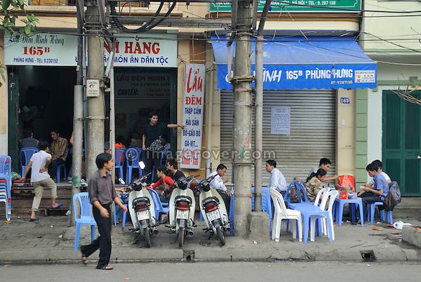 Asia, Vietnam, Hanoi. Hanoi old quarter. Roadside restaurant.