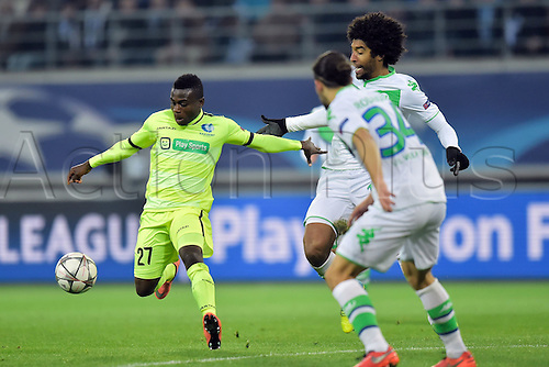 17.02.2016. Gent, Belgium. UEFA Champions League football. KAA Gent versus VfL Wolfsburg.  Simon Moses Daddy Ajala forward of KAA Gent in front of Dante defender of VfL Wolfsburg