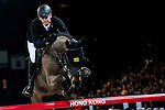Marco Kutscher of Germany rides Cornet's Cristallo at the Longines Grand Prix during the Longines Hong Kong Masters 2015 at the AsiaWorld Expo on 15 February 2015 in Hong Kong, China. Photo by Xaume Olleros / Power Sport Images