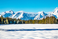 The Grand Teton mountains in winter in Grand Teton National Park in Wyoming.