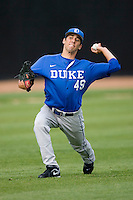 Christopher Manno #49 of the Duke Blue Devils throws in the outfield at the Wake Forest Baseball Park April 23, 2010, in Winston-Salem, NC.  Photo by Brian Westerholt / Sports On Film