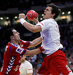 Rasmus Lauge Schmidt (R) of Denmark and Marko Prodanovic (L) of Serbia in action during men`s EHF EURO 2012 handball championship final game between Serbia and Denmark in Belgrade, Serbia, Sunday, January 29, 2011.  (photo: Pedja Milosavljevic / thepedja@gmail.com / +381641260959)