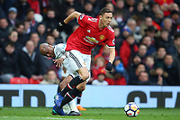 Andre Ayew of Swansea City competes with Nemanja Matic of Manchester United during the Premier League match between Manchester United and Swansea City at the Old Trafford, Manchester, England, UK. Saturday 31 March 2018