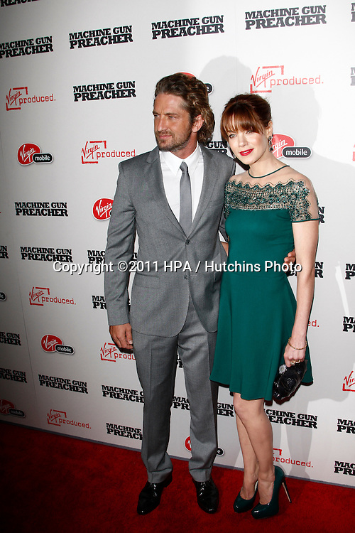 "LOS ANGELES - SEPT 21:  Gerard Butler, Michelle Monaghan arriving at the ""Machine Gun Preacher"" Los Angeles Premiere at Academy of Motion Pictures Arts & Sciences on September 21, 2011 in Beverly Hills, CA"