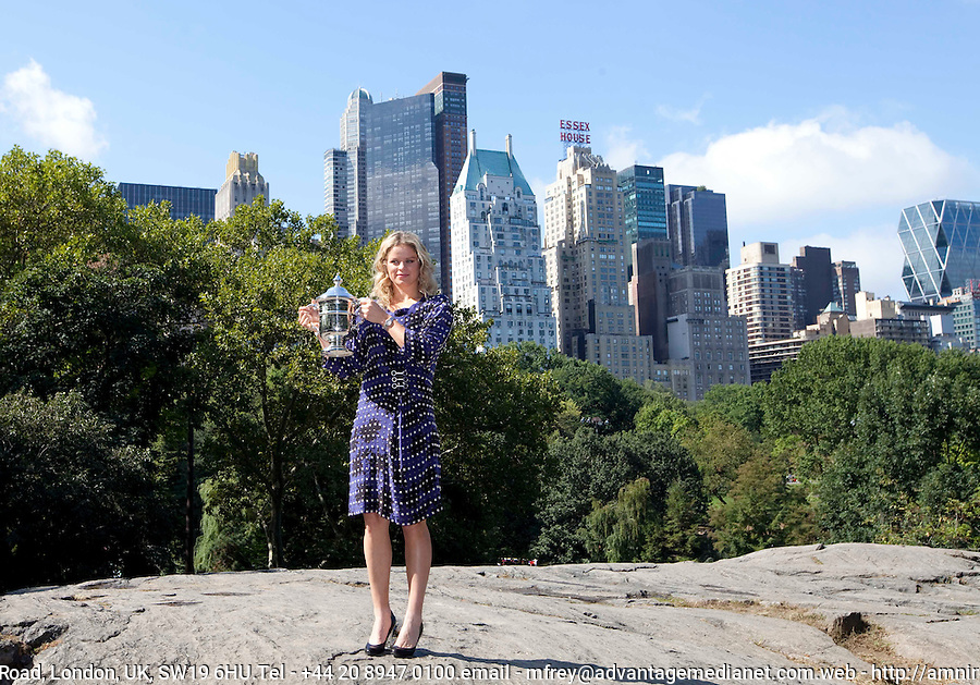 2010 Women's singles Champion, Kim Clijsters, with the trophy in Central Park, New York..International Tennis - US Open - Day 15 - 13 Sep 2010 - USTA Billie Jean King National Tennis Center - ..© AMN Images, Level 1, Barry House, 20-22 Worple Road, London, UK, SW19 6HU.Tel - +44 20 8947 0100.email - mfrey@advantagemedianet.com.web - http://amnimages.photoshelter.com/.web - www.advantagemedianet.com