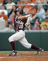 Texas A&M C Kevin Gonzalez singles against Texas on May 16th, 2008 in Austin Texas. Photo by Andrew Woolley / Four Seam images.
