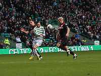 Gary Hooper sandwiched between Paul Dummett and Jim Goodwin in the Celtic v St Mirren Clydesdale Bank Scottish Premier League match played at Celtic Park, Glasgow on 15.12.12.