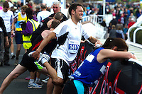 09 SEP 2011 - CHESTER, GBR - Tim Hatt stretches as he recovers after finishing the MBNA Chester Marathon .(PHOTO (C) NIGEL FARROW)