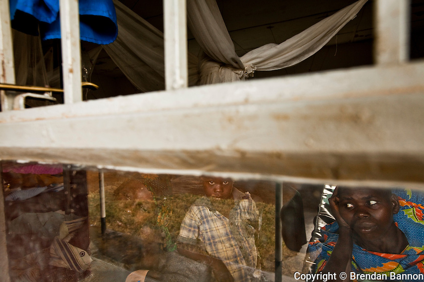 Patients looking out  the window in an MSF supported clinic in Madi Opei, Uganda.