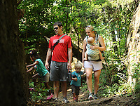 NWA Democrat-Gazette/ANDY SHUPE<br /> E.J. and Erin Roussell of Fayetteville hike Saturday, Aug. 29, 2015, with their children Luke, 2, and Owen 8 months, along the trail on Mount Kessler in Fayetteville. A master trails plan is being developed that will be used to manage and extend about seven miles of soft-surface nature trails atop the wooded hillside in southwest Fayetteville.