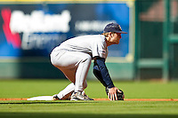 Shortstop Derek Hamilton #4 of the Rice Owls tries to field a low throw at second base against the Baylor Bears at Minute Maid Park on March 6, 2011 in Houston, Texas.  Photo by Brian Westerholt / Four Seam Images