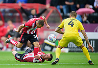 Lincoln City's Jack Payne and Harry Toffolo (3) vies for possession with Fleetwood Town's Peter Clarke<br /> <br /> Photographer Andrew Vaughan/CameraSport<br /> <br /> The EFL Sky Bet League One - Lincoln City v Fleetwood Town - Saturday 31st August 2019 - Sincil Bank - Lincoln<br /> <br /> World Copyright © 2019 CameraSport. All rights reserved. 43 Linden Ave. Countesthorpe. Leicester. England. LE8 5PG - Tel: +44 (0) 116 277 4147 - admin@camerasport.com - www.camerasport.com