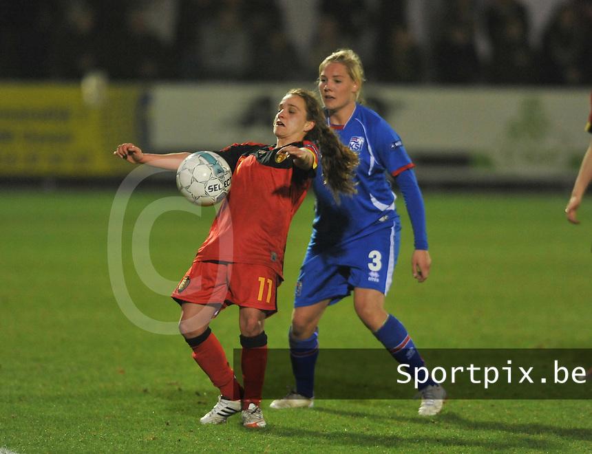 Qualification Women's Euro 2013 - Belgium - Iceland ; Belgie - Ijsland ; Armand Melis Stadion Dessel :.Davina Philtjens aan de bal voor Rakel Honnudottir.foto DAVID CATRY / Vrouwenteam.be