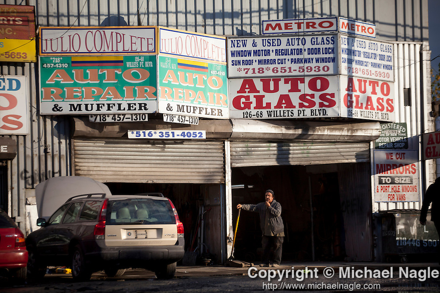 QUEENS, NY -- OCTOBER 22, 2013:  A man waits for a customer in Willets Point on October 22, 2013 in Queens.  Photographer: Michael Nagle for The New York Times