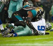 09.11.2014.  London, England.  NFL International Series. Jacksonville Jaguars versus Dallas Cowboys.  Dallas Cowboys' Quarterback Tony Romo (#9) is sacked by Jaguars' Sen'Derrick Marks (#99)