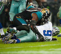 09.11.2014.  London, England.  NFL International Series. Jacksonville Jaguars versus Dallas Cowboys.  Dallas Cowboys' Quarterback Tony Romo (#9) is sacked by Jaguars' Sen'Derrick Marks (#99)