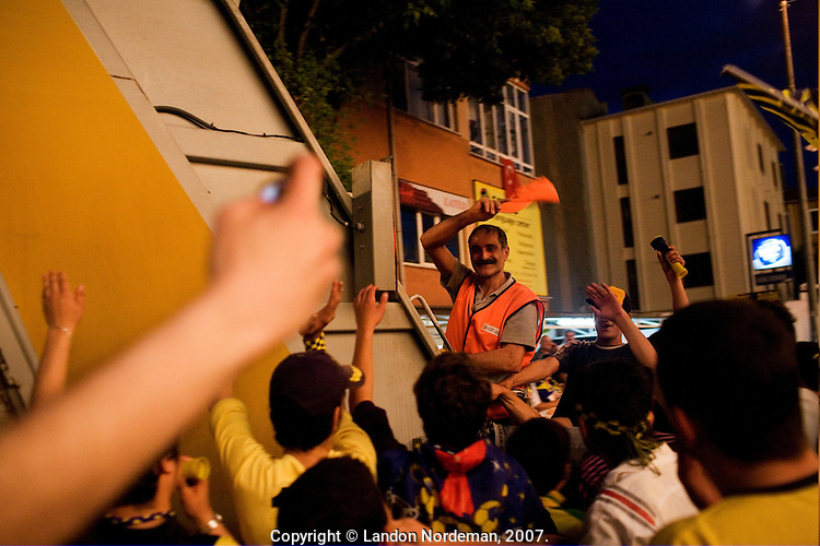 ISTANBUL - MAY 26, 2007:   People celebrate Fenerbahce soccer team in Istanbul, Turkey. Photo by Landon Nordeman.