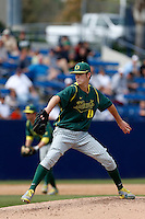 Cole Irvin #19 of the Oregon Ducks pitches against the Cal State Fullerton Titans at Goodwin Field on March 3, 2013 in Fullerton, California. (Larry Goren/Four Seam Images)