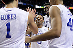 Kentucky guard Tyler Ulis high fives his teammates after the second half of the University of Kentucky men's basketball game vs. University of North Carolina at Rupp Arena in Lexington , Ky., on Friday, December 12, 2014. Kentucky won 84 - 70 over North Carolina Photo by Jonathan Krueger | Staff