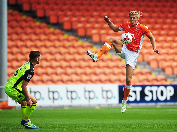 Blackpool's Brad Potts takes the aerial ball despite the attentions of Exeter City's Jordan Moore-Taylor<br /> <br /> Photographer Kevin Barnes/CameraSport<br /> <br /> Football - The EFL Sky Bet League Two - Blackpool v Exeter City - Saturday 6th August 2016 - Bloomfield Road - Blackpool<br /> <br /> World Copyright © 2016 CameraSport. All rights reserved. 43 Linden Ave. Countesthorpe. Leicester. England. LE8 5PG - Tel: +44 (0) 116 277 4147 - admin@camerasport.com - www.camerasport.com