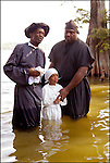 A 100 yr. Tradition of rural African American Baptisms on Moon Lake, in the Mississippi Delta held once a year in the same spot on the lake. The First candidate for baptism is pictured in the water before he is Baptised. (photo &copy; Suzi Altman) Description/Caption:<br />