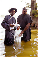 A 100 yr. Tradition of rural African American Baptisms on Moon Lake, in the Mississippi Delta held once a year in the same spot on the lake. The last candidate for baptism is pictured leaving the water. (photo&copy;Suzi Altman. Description/Caption:<br />