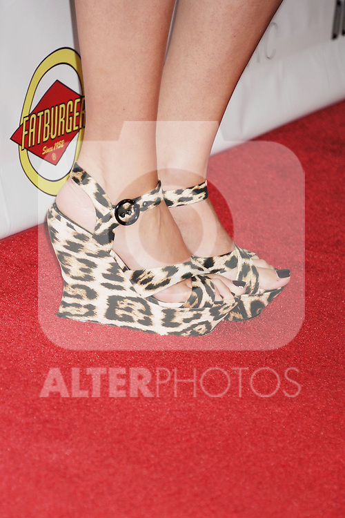 HOLLYWOOD, CA - AUGUST 23: Lindsay Sloane (leopard print shoe detail) at the Los Angeles premiere of 'Bachelorette' at the Arclight Hollywood on August 23, 2012 in Hollywood, California. /NortePhoto.com.... **CREDITO*OBLIGATORIO** *No*Venta*A*Terceros*..*No*Sale*So*third* ***No*Se*Permite*Hacer Archivo***No*Sale*So*third*