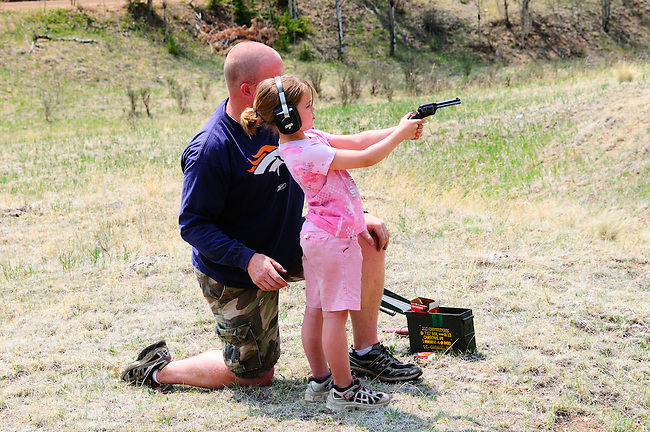Girl receiving firearm safety training, MR: Yes