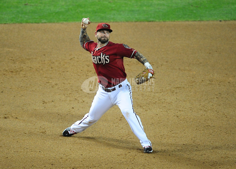 May 9, 2012; Phoenix, AZ, USA; Arizona Diamondbacks third baseman Ryan Roberts makes a throw to first base in the fifth inning against the St. Louis Cardinals at Chase Field. Mandatory Credit: Mark J. Rebilas-
