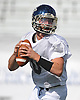 Long Island quarterback John Daniggelis of Smithtown High School East looks downfield during a football team practice held at Hofstra University on Monday, June 22, 2015. The best of Nassau and Suffolk Counties will take on their New York City counterparts in the annual Empire Challenge at Hofstra on Tuesday, June 23 at 7:00PM.<br /> <br /> James Escher