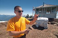 Dan the Fire Lookout Showing Off Unique Cone of Subalpine Fir (Abies lasiocarpa), Desolation Peak, North Cascades National Park, Washington, US