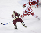 Nathan Gerbe 9 of Boston College puts the puck past Kyle Klubertanz 20 of the University of Wisconsin and Brian Elliott 1 of the University of Wisconsin to open scoring. The Boston College Eagles defeated the University of Wisconsin Badgers 3-0 on Friday, October 27, 2006, at the Kohl Center in Madison, Wisconsin in their first meeting since the 2006 Frozen Four Final which Wisconsin won 2-1 to take the national championship.<br />