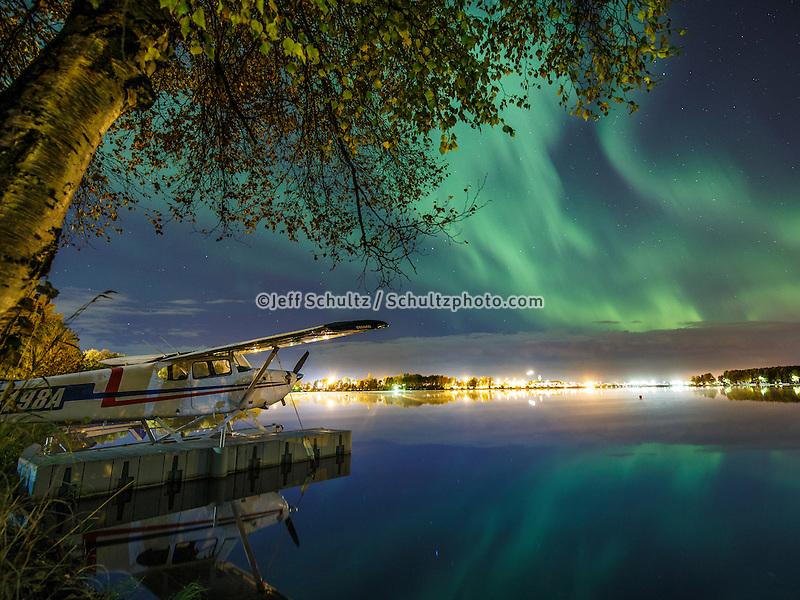 Northern Lights (Aurora Borealis) light up the sky over  Anchorage, Alaska .  Lake Hood and float plane  September 2015