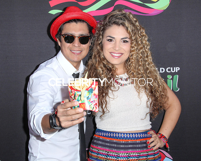 NEW YORK CITY, NY, USA - JUNE 05: Periko Leon, Jessi Leon at the 2014 FIFA World Cup McDonald's Launch Party held at Pillars 38 on June 5, 2014 in New York City, New York, United States. (Photo by Jeffery Duran/Celebrity Monitor)