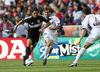 3 April 2004:  DC United Jamie Moreno dribbles the ball away from Earthquakes Brian Mullan during the opening day at RFK Stadium in Washington DC.  DC United defeated Earthquakes 2-1.