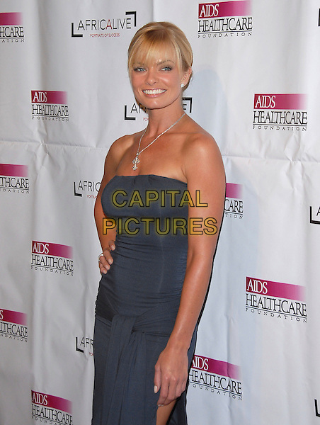 JAIME PRESSLY.attends The Hot in Hollywood benefit for The AIDS Healthcare Foundation held at The Henry Fonda Music Box in Hollwyood, California, USA, August 12, 2006..half  length jamie strapless grey blue dress leg thigh slit split hand on hip.Ref: DVS.www.capitalpictures.com.sales@capitalpictures.com.©Debbie VanStory/Capital Pictures