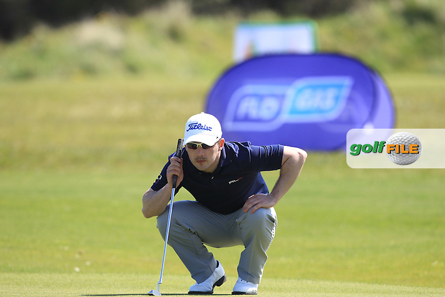 Daniel Holland (Castle) on the 18th green during Round 4 of the Flogas Irish Amateur Open Championship at Royal Dublin on Sunday 8th May 2016.<br /> Picture:  Thos Caffrey / www.golffile.ie