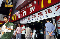 A customer leaves a McDonalds' restaurant in Shanghai.