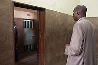 Detective Simiyu waiting for  his suspect to be realsed from the cell for interrogation.