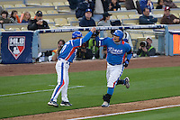 21 March 2009: #52 Tae Kyun Kim of Korea runs the bases as he hits an homerun during the 2009 World Baseball Classic semifinal game at Dodger Stadium in Los Angeles, California, USA. Korea wins 10-2 over Venezuela.