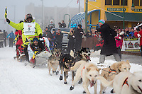 Newton Marshall and team leave the ceremonial start line at 4th Avenue and D street in downtown Anchorage during the 2013 Iditarod race. Photo by Jim R. Kohl/IditarodPhotos.com