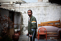 Greece/ Piraeus/ Nov. 23. 2012. Housam 36 years old from Egypt lives in Greece for twelve years under the humanitarian protection because of serious health problems he faces. He was attacked by two men with black, when they heard him speaking Arabic on his phone, from this day he needs help to walk. Racially motivated, brutal attacks and hate crimes have become an almost daily phenomenon in Greece that goes over its fifth year of recession.   .Giorgos Moutafis