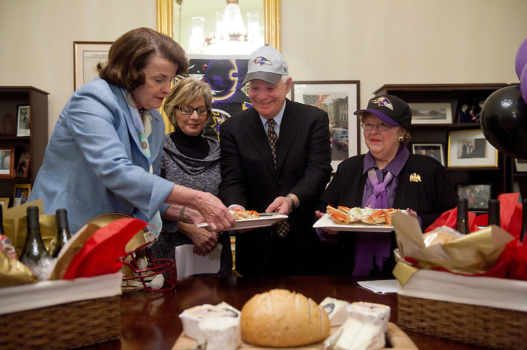 UNITED STATES - FEBRUARY 7: Sen. Dianne Feinstein, D-Calif.; and Sen. Barbara Boxer, D-Calif.; pay off a Supr Bowl bet with Sen. Ben Cardin, D-Md; and Sen. Barbara Mikulski, D-Md. Following the Baltimore Ravens' victory over the San Francisco 49ers, the California Senators gave them Dungness crab, Napa Valley wine, sourdough bread and a selection of Northern California cheeses. (Photo By Chris Maddaloni/CQ Roll Call)