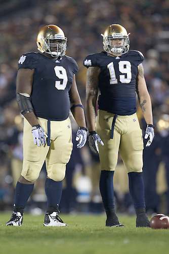 Notre Dame nose guard Louis Nix III (#9) and defensive end Aaron Lynch (#19) during second quarter of NCAA football game between Notre Dame and Boston College.  The Notre Dame Fighting Irish defeated the Boston College Eagles 16-14 in game at Notre Dame Stadium in South Bend, Indiana.