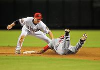 Sept. 12, 2008; Phoenix, AZ, USA; Arizona Diamondbacks shortstop Stephen Drew tags out Cincinnati Reds base runner (21) Chris Dickerson on a steal attempt in the sixth inning at Chase Field. Mandatory Credit: Mark J. Rebilas-
